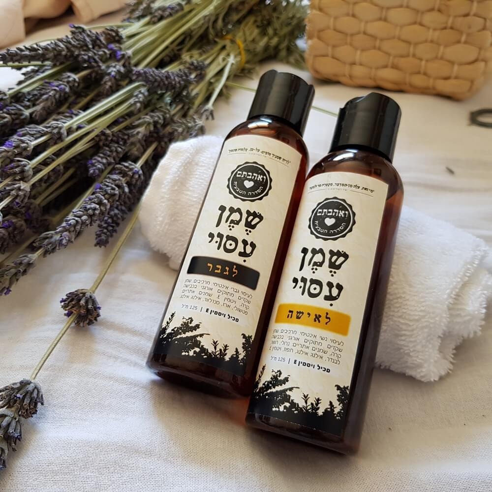 A pair of intimate massage oils for men and women, each one 125 ml.